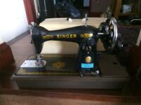 An old hand cranked Singer sewing machine