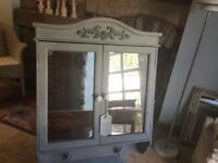 Mirrored chalk painted small wall cabinet.