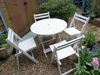 LOVELY TRADITIONAL HARD WOOD TABLE AND FOUR FOLD UP CHAIRS