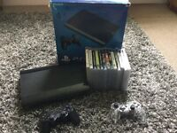 PS3, 500GB hard drive, 2 controllers and assortment of games