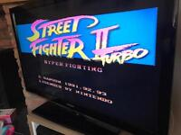 Boxed Super Nintendo with street fighter 2