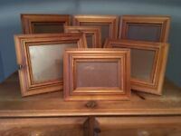 Solid pine wall mounted picture frames in two different sizes.