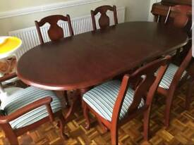 Dining room table with 6 chairs.