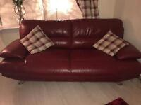 Red 3 seater leather sofa.