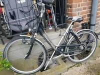 Gazelle orange woman's bike with lock wheels system