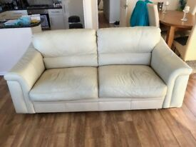 Cream leather three seater sofa & two armchairs.