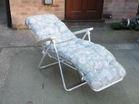 Reclining sun lounger with full length padded cushion
