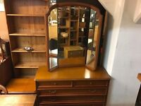 A LONG CHEST OF DRAWERS WITH MATCHING BEDSIDE TABLE AND A LARGE MIRROR