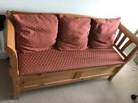 Upholstered pine storage bench with cushions