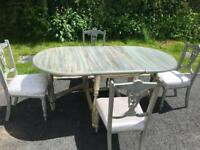 Antique chairs and leaf fold down table