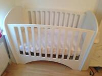White wooden cot with mattresses