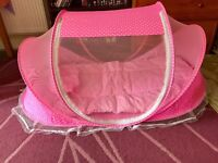 Pink folding baby travel bed with mosquito net