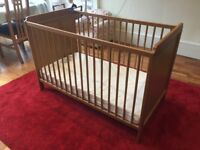 IKEA wooden cot in good condition. Perfect for 0-2 years old.