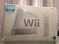 Nintendo Wii complete with 4 Games