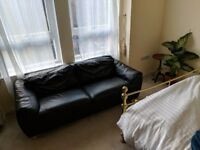 Black leather couch/sofa in great condition