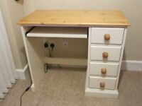 Small cream painted computer desk with a pine top.