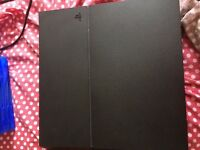 Playstation 4 500Gb (black) with a controller