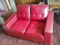 Red leather look settee, hardly used, sale due to breavement.