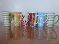 6 tall, colourful mugs