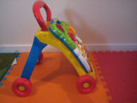 BABY/ TODDLER ACTIVITY WALKER BY V TEC WITH LIGHTS MUSIC AND SOUNDS