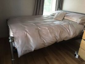 Metal Framed Double bed in EXCELLENT Condition with sprung mattress