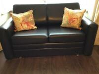 Sofa bed brown faux leather.