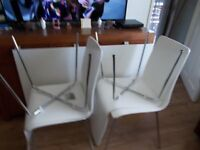 white table and 4 chairs in brilliant condition
