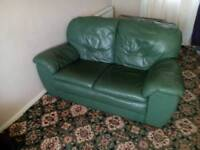 Two seater leather in green sofa.