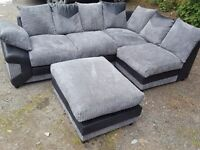 Really nice black and grey corner sofa and footstool. or larger corner.1 month old.clean.can deliver