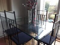 Elegant glass and black metal table + 6 chairs for sale