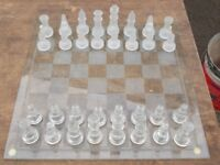 GLASS CHESS SET AND GLASS BOARD. PICK UP MATLOCK OR NOTTINGHAM