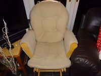 Nursing/ rocking chair in beige fabric with matching rocking foot stool