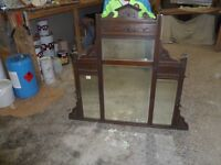 Antique mahogany fireplace over mantle.