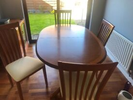 Solid Teal extending dining table and 4 chairs