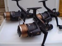 set of three shimano 8010 baitrunner reels with stainless steel rims in excellent condition