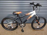 CHILDS FLAME FRONT SUSPENSION BIKE IN EXCELLENT ALMOST NEW CONDITION, (SUIT APPROX. AGE. 6 / 7+).