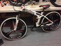 """Mountain bike 19"""" folding used less than a week 21 speed full suspension"""