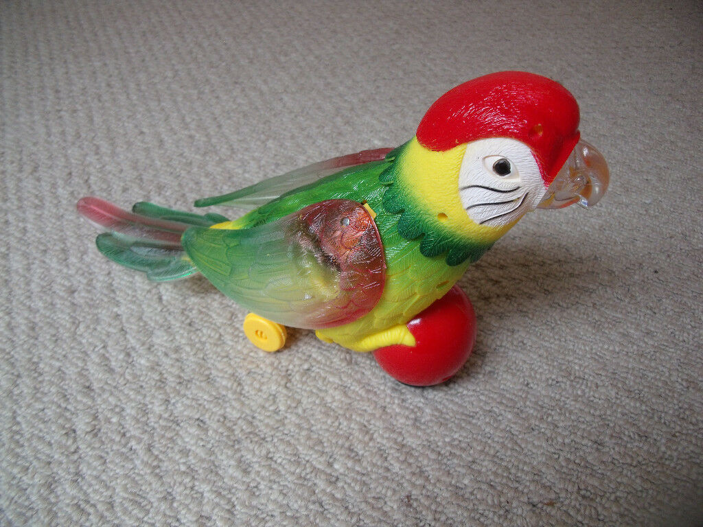 Musical, dancing, light-up parrot on a ball toy - great fun! Excellent condition. Good working order