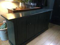 dark green painted wooden sideboard