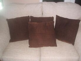Four Brown satin square cushions