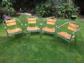 Four cafe/bistro style chairs.