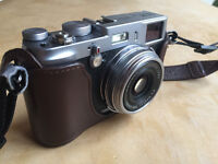 Fuji X100 Camera with genuine case, strap and original box, charger and battery