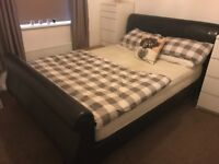King size brown sleigh bed