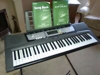 Yamaha keyboard with stand excellent condition.