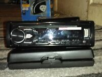 Two modern car stereos pioneer and radiomobile