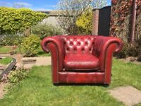 Chesterfield burgundy leather armchair and footstool.
