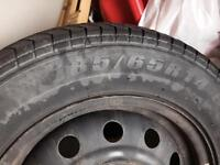 Selling four 185/65 R 14 tires with rims