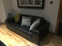 Three piece leather black/ brown sofa (3seater & (2 )1 Seaters rarely sat on excellent condition
