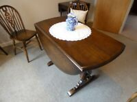Solid Oak Drop Leaf Dining Table and 5 Dining Chairs