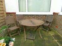 Wooden Garden Table and 4 Chairs in good condition
